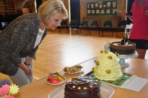 woman looking at a table full of cakes