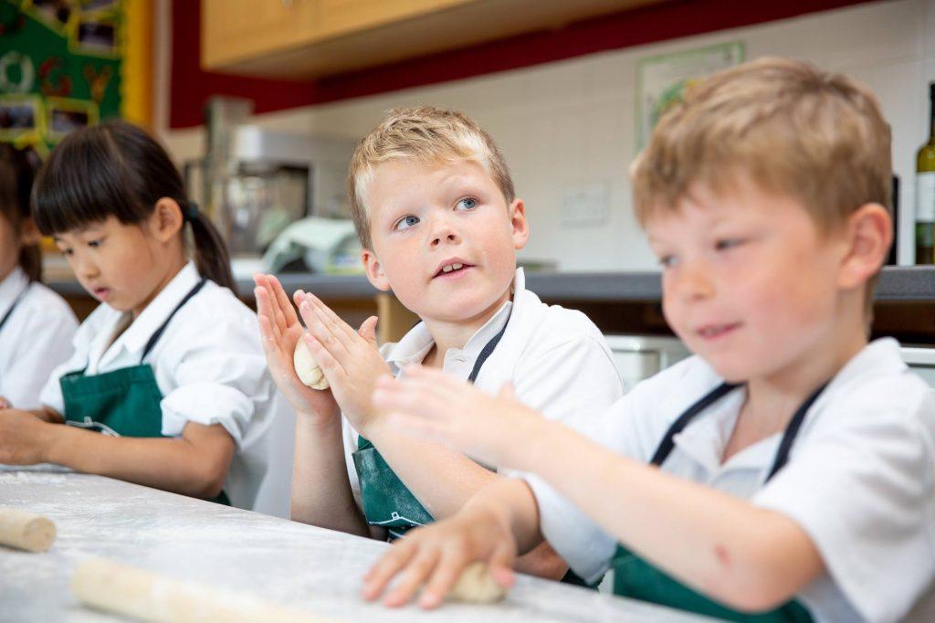 school children in food technology lesson