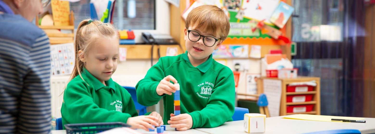 reception children playing with building blocks