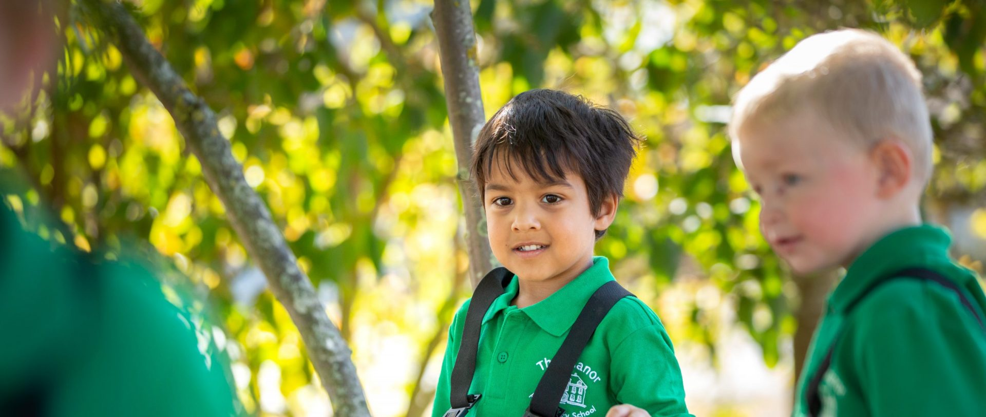 nursery aged children learning outdoors